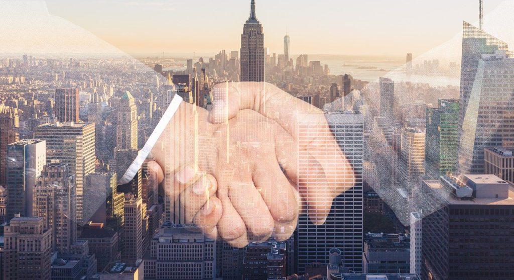 shaking hands, handshake, skyline-3096229.jpg